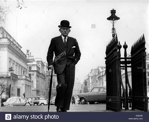 Man with umbrella and bowler hat in London Stock Photo