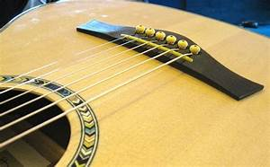 How To Lower Action On Acoustic Guitar