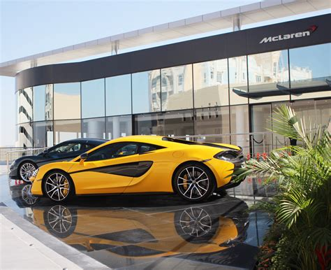 mclaren dealership mclaren opens new dealers from bahrain to denver carscoops