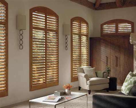 Custom Blinds And Shutters by Interior Shutters Arch Top Stained Shutters