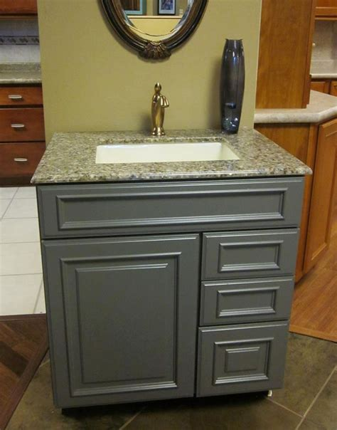 This vanity features KraftMaid Cabinetry. The door style