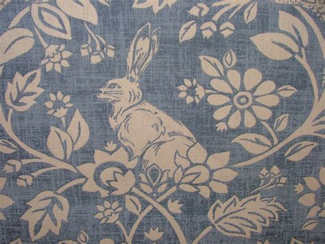 Curtain And Upholstery Fabrics by Heathland Hares And Birds Indigo Cotton Designer