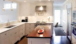 white kitchen island with butcher block top white shaker kitchen cabinets transitional kitchen elsa soyars