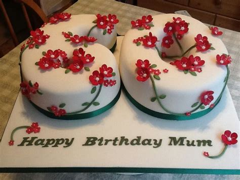 Classy and elegant golden drizzle 60th birthday cake with a pretty posy of blooms and hand painted sixy. Pin on Party Time
