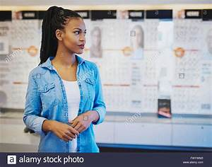 Young confident woman opening own store, black female ...