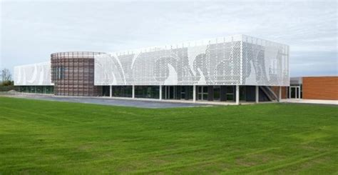 pad architects wraps office with a wavy perforated