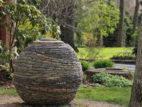 stacked stone garden sphere garden design