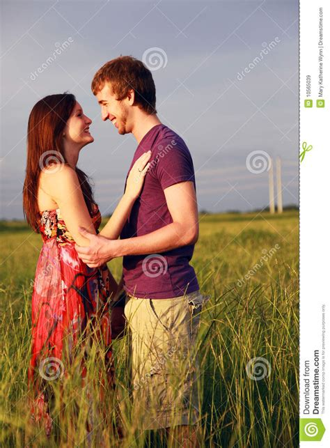 happy lovers  field royalty  stock images image