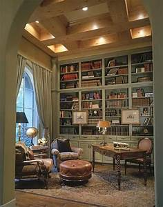 A library in a French-style house. Bookcases run all the ...