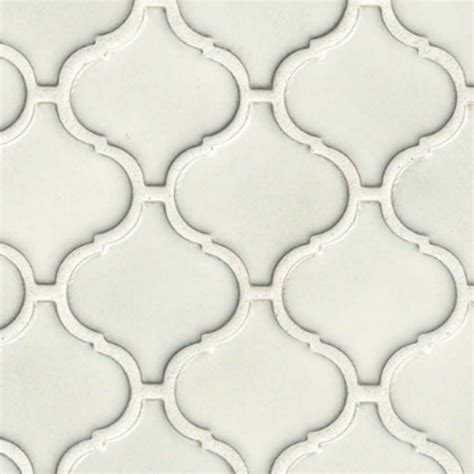 white arabesque tile mosaic monday creating a unique wall or backsplash with