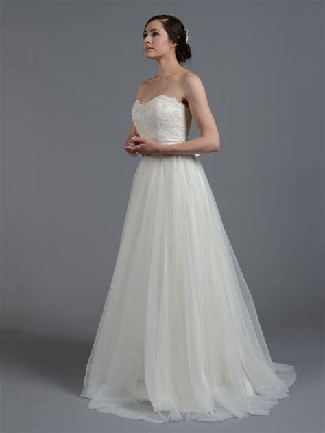 ivory strapless lace wedding dress with tulle skirt