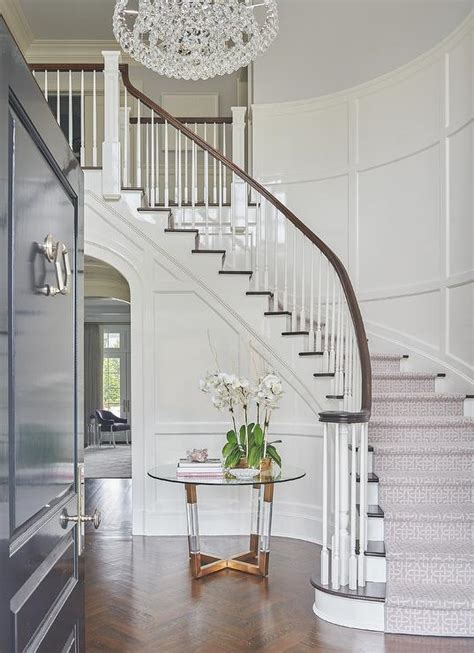 brass  lucite accent table  curved staircase