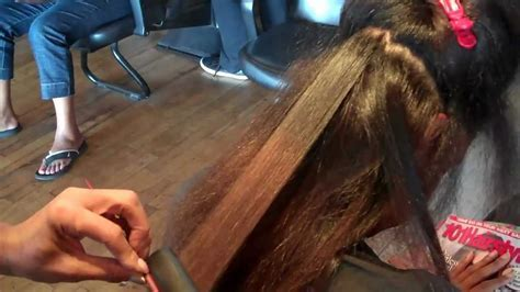 weave and silk press demonstrated by Charles Gregory Salon