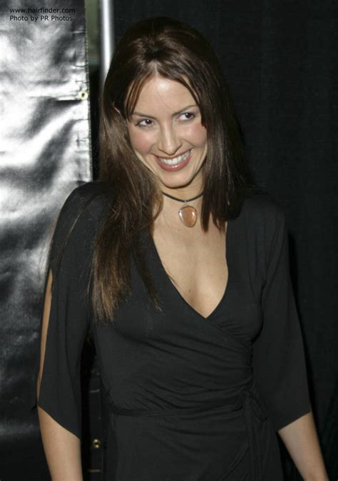 michelle clunie   long brown hair styled straight    shoulders