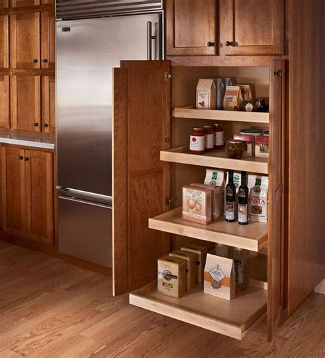 kraftmaid kitchen wall cabinets kraftmaid roll out trays the utility cabinet on the back