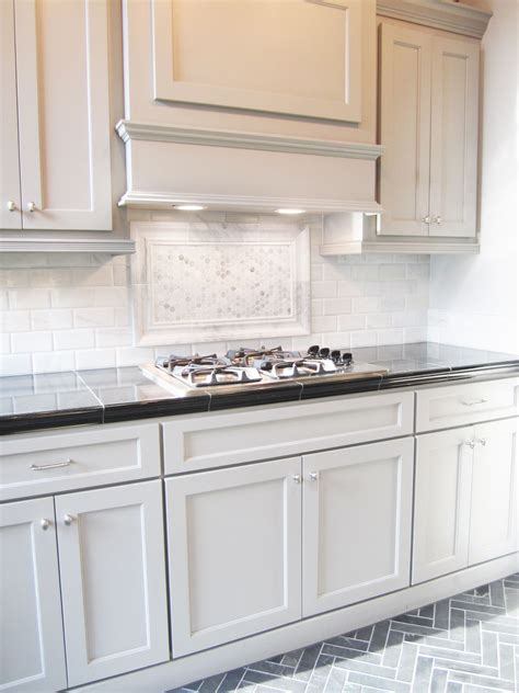 herringbone backsplash kitchen this striking marble backsplash pairs well with these 1606