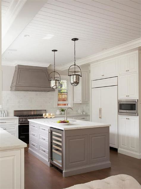 gray paneled kitchen hood  mercury glass bell pendants