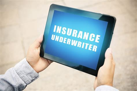 Check spelling or type a new query. Man holding tablet with text INSURANCE UNDERWRITER on screen out   United Final Expense Services