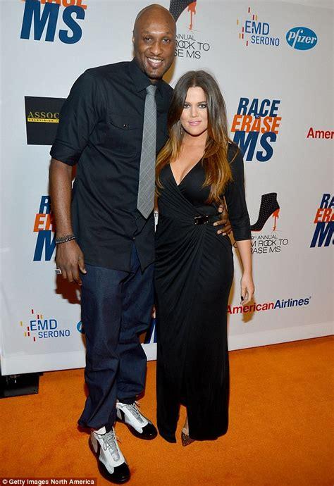Kanye's got her back! Downcast Khloe Kardashian hides her ...