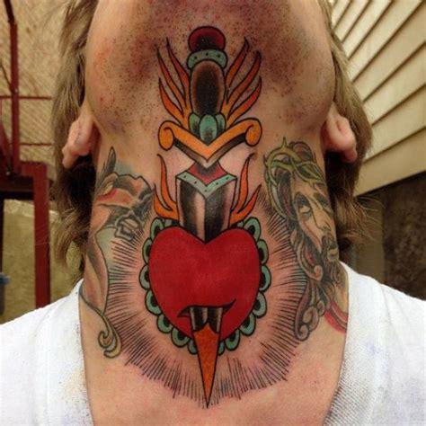 heart neck chin dagger tattoo  sacred tattoo studio