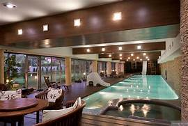 Indoor Swimming Pool With Garden Views At Dusk Interior Design Ideas Some Indoor Swimming Pool For You House Indoor Swimming Pool Long And Narrow Indoor Pool Inside Pool Ideas Indoor Swimming Pool Designs With Fantasy Indoor Swimming