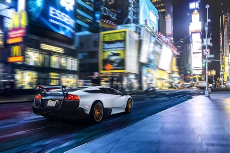 car times square  york city motion blur usa night