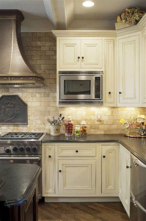 mediterranean kitchen with white cabinets mediterranean kitchen design travertine tile backsplash