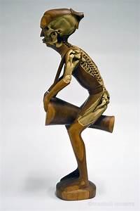 Artist maskull lasserre carves imagined skeletons into for Artist maskull lasserre carves imagined skeletons into souvenir sculptures and decoys