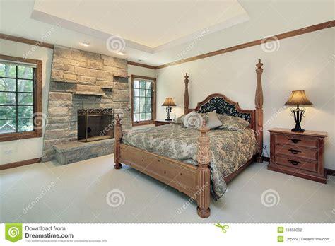 photographie à la chambre chambre à coucher principale avec la cheminée en