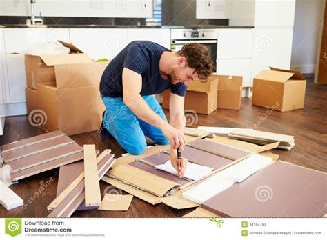 self assembly furniture man putting together self assembly furniture in new home stock image image of assembling