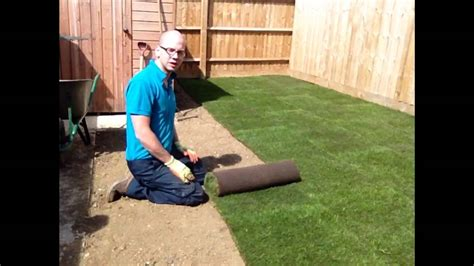 installing lawn how to lay turf a new lawn youtube