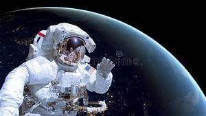 Close Up Of An Astronaut In Outer Space, Earth By Night In ...