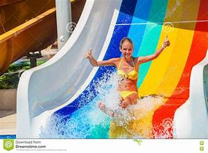 Child On Water Slide At Aquapark Show Thumb Up. Stock ...