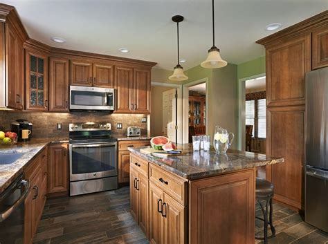warm cozy kitchen featuring wolf classic cabinets