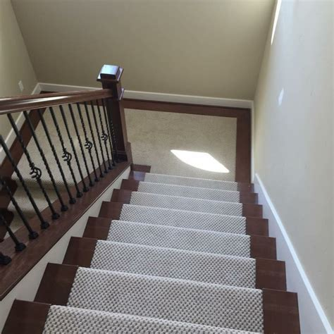 Gorgeous carpet with laminate border stairs! Call Big Bens