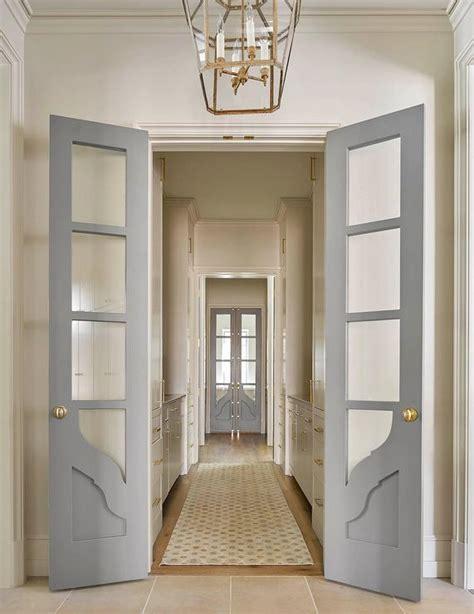 gray pantry doors  aged brass oval door knobs