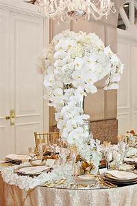 long trailing stunning centerpiece in white orchids With orchid decorations for weddings