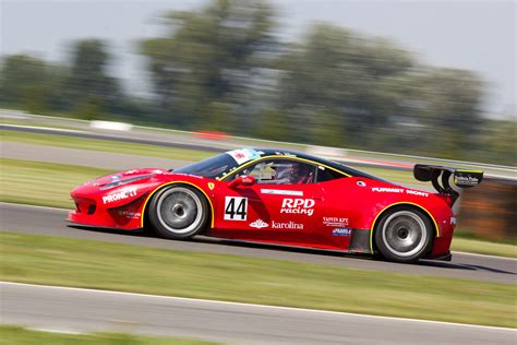 Red Racing Car On Race Track During Daytime · Free Stock Photo