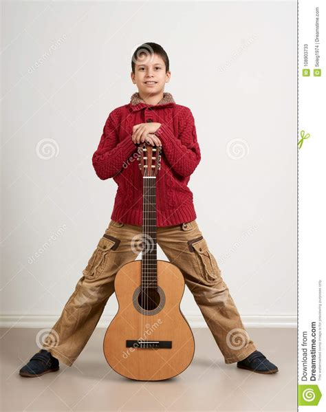 Learning music is not always fun for kids, but it should be! Boy Having Fun With Guitar, Making Music And Singing Stock Image - Image of country, play: 108903733