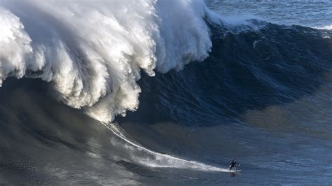 riding monster waves  andrew cotton