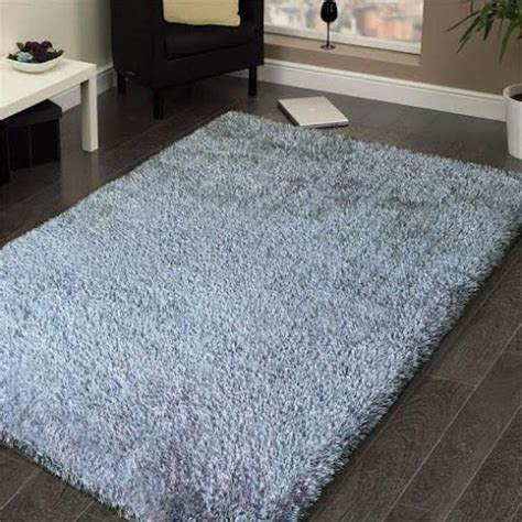 They both can offer storage, function as tables, and serve as a central focal point and spot for decor. Shaggy Viscose Rug Solid Silver - Casye Furniture