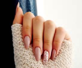 Almond shaped acrylic nails with a glitter statement nail