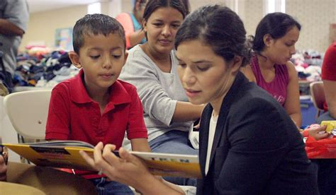 Actress America Ferrera reads a book to a Central American