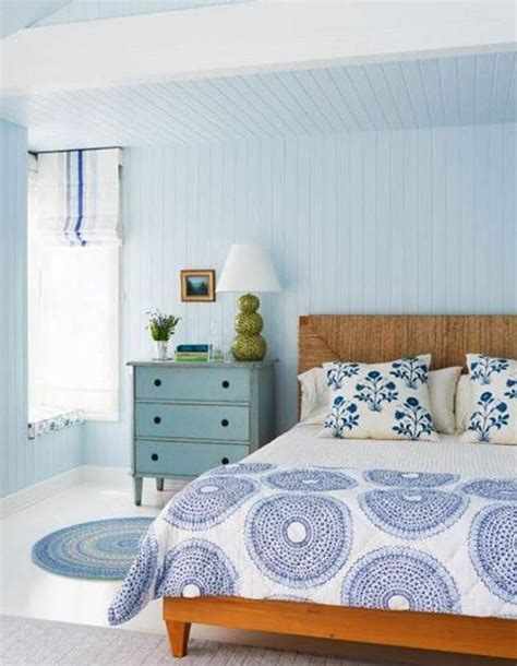 lovely light blue walls of bedroom with wood bed