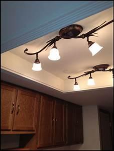 Kitchen replacing fluorescent light fixtures