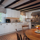 brick floor kitchen Kitchen Traditional with beadboard