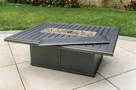 """Stay warm outside with one of tropitone s fire pits. Tropitone Banchetto 54x42"""" Rectangular Fire Pit - Leisure ..."""