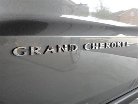 jeep grand cherokee door emblem chrome part  aa