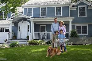 Family With Dog Standing In Front Of House Portrait Stock ...