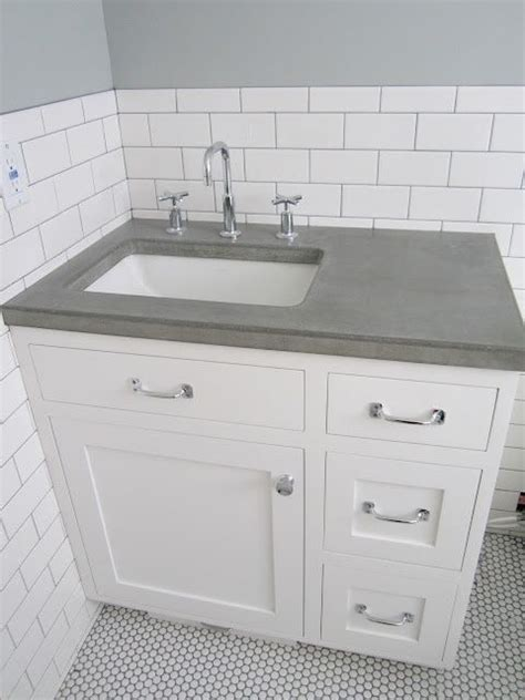 white vanity grey top offset sink concrete countertop